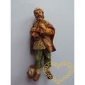 Dudák v čepici s trojhlasými dudami - figurka