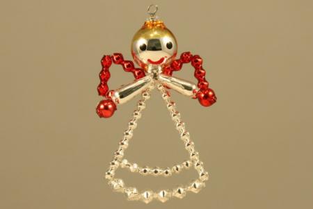 Hobby set - vánoční ozdoba andělíček červený. Chcete si sami vyrobit vlastní vánoční skleněnou ozdobu? Nebo někomu věnovat milý tvořivý dáreček? K tomu Vám výborně poslouží tento hobby set. Každé balení obsahuje veškerý potřebný materiál k výrobě dan