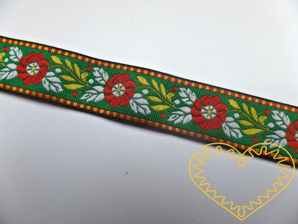 Zelená krojová stuha se vzorem - vzorovka - šíře 2,5 cm. Textilní tkaná stuha s modrými květy a červenými a zelenými lístky se uplatní zvláště při výrobě krojů a předmětů tradiční lidové kultury. Vhodná též k lemování tkanin a šatů panenek a maňásků.
