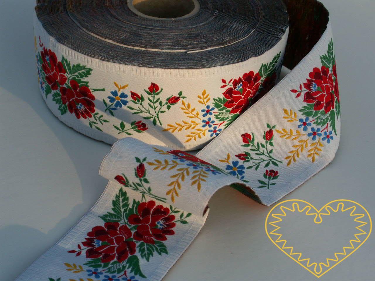 Bílá krojová stuha s bohatým květinovým vzorem - vzorovka š 5,5 cm. Textilní tkaná stuha je vhodná zvláště k lemování tkanin, zdobení krojů a šatů panenek a maňásků.