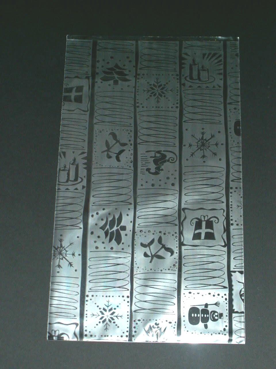 Lesklé stříbrné polypropylenové sáčky o rozměrech 20 x 35 cm. Zadní zlatá stěna má na sobě zlatý metal tisk s vánočními motivy (balíček, jmelí, stromeček, svíčky apod.), přední stěna je transparentní.
