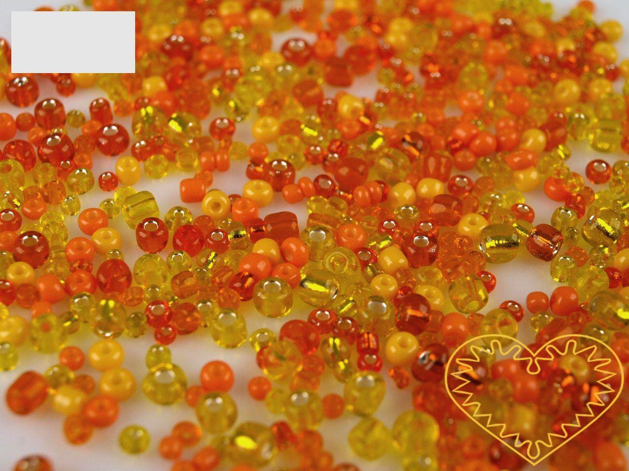 Oranžový mix skleněných korálků - balení 50 g. V mixu jsou obsaženy korálky velikosti 2, 3 a 4 mm v oranžové barvě různých odstínů. Korálky jsou vhodné pro tvoření s dětmi, pro výrobu bižuterie i dalších ozdob.