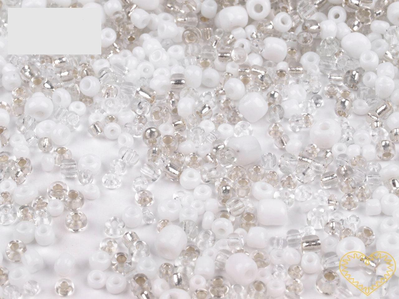 Bílý mix skleněných korálků - balení 50 g. V mixu jsou obsaženy korálky velikosti 2, 3 a 4 mm v bílé a čiré barvě různých odstínů. Korálky jsou vhodné pro tvoření s dětmi, pro výrobu bižuterie i dalších ozdob.