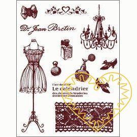 Gelová razítka - dámské nezbytnosti (14 x 18 cm). Na kartě najdete mašli, krejčovskou pannu se šaty, parfémy, střevíčky, krajku, lustr se svíčkami, ornament se srdíčky, nápisy. Velkou výhodou gelových razítek je to, že přesně vidíte místo, kam razítk