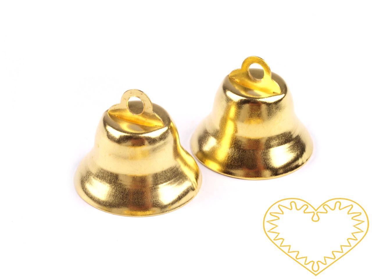 Zlatý kovový zvoneček 12 x 20 mm - 1 ks. Zvonečky mají srdce z plíšku, takže skutečně zvoní. Vhodné pro tvorbu dekorací a vánočních aranžmá.