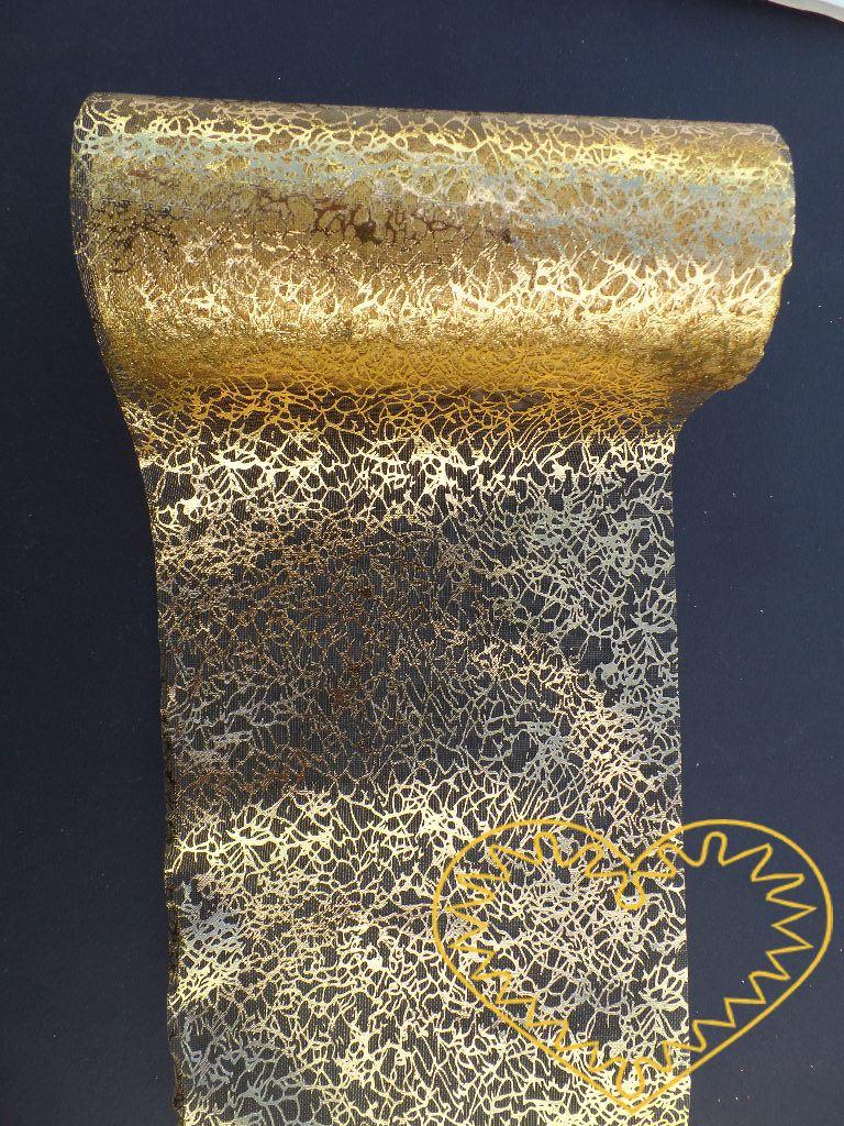Zlatá organza mramor - šíře 12 cm. Má zajímavou mramorovanou strukturu. Vhodná k dekorování, šití, aranžování, pro výzdobu slavnostní tabule, balení dárků, výrobu ozdob apod.