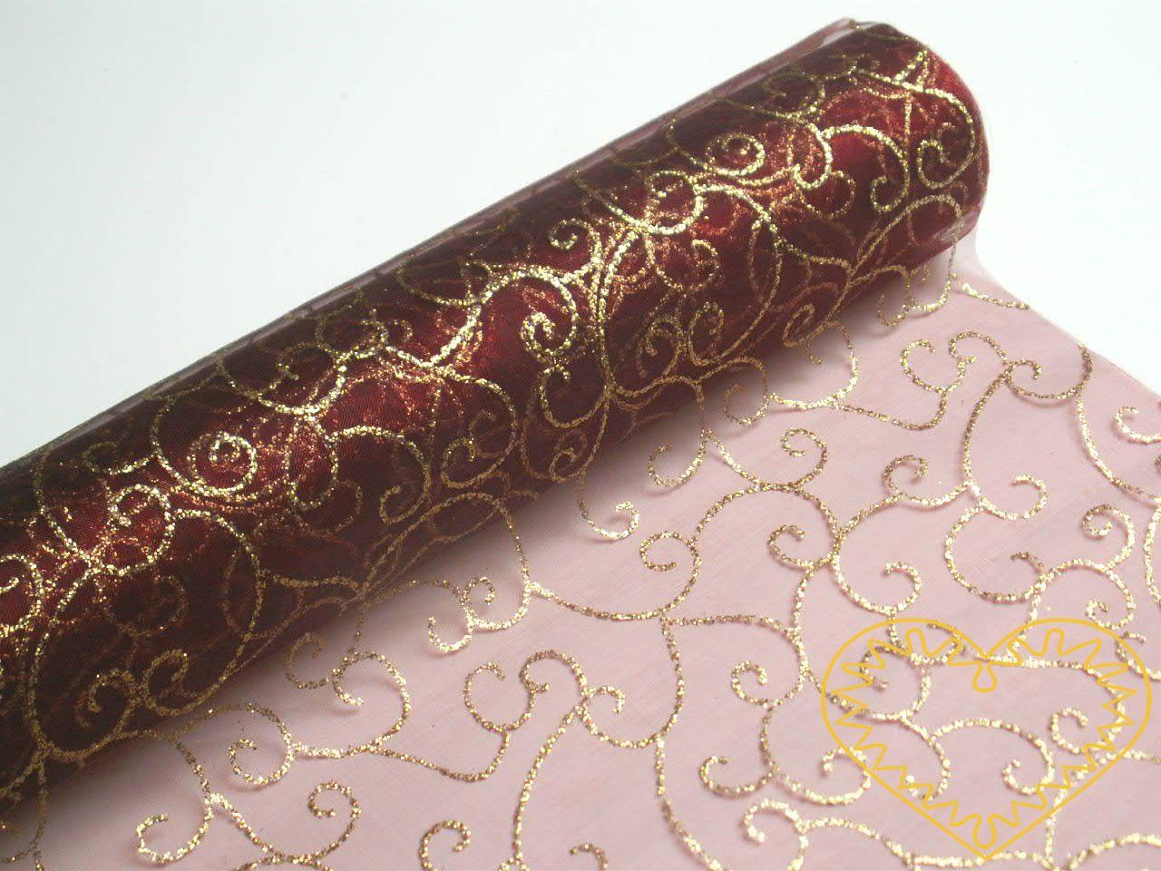 Organza bordó se zlatým třpytivým vzorem - šíře 40 cm, délka 5 m. Vypadá velice slavnostně a reprezentativně. Vhodná k dekorování, aranžování a výzdobě slavnostní tabule, pro balení dárků, ozdob, broží apod.
